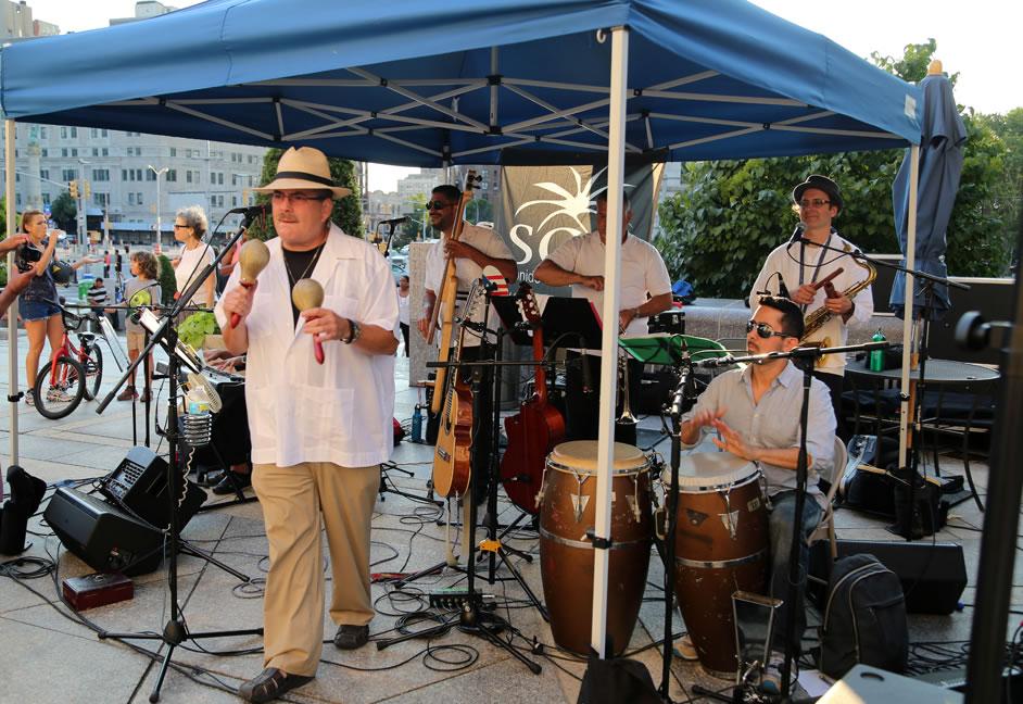 JuanMa-playing-maracas-dancing-band-BPL-outdoor-music-series-concert